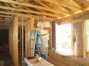 Rev. Scott Mauch doing the electrical work at the new build